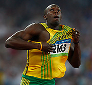 epa01458639 Jamaica's Usain Bolt celebrates winning the men's 200m final at the Beijing 2008 Olympic Games, China,  20 August 2008. Bolt won in new World Record time of 19.30 seconds.  EPA/Nic Bothma