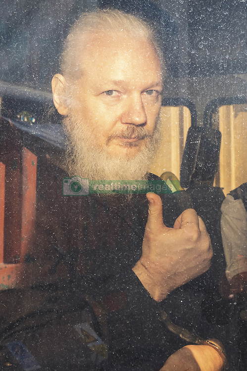 April 11, 2019 - London, London, UK - London, UK. Wikileaks founder Julian Assange arrives at Westminster Magistrates Court in a police escort to appear where he faces an extradition warrant. (Credit Image: © Rob Pinney/London News Pictures via ZUMA Wire)