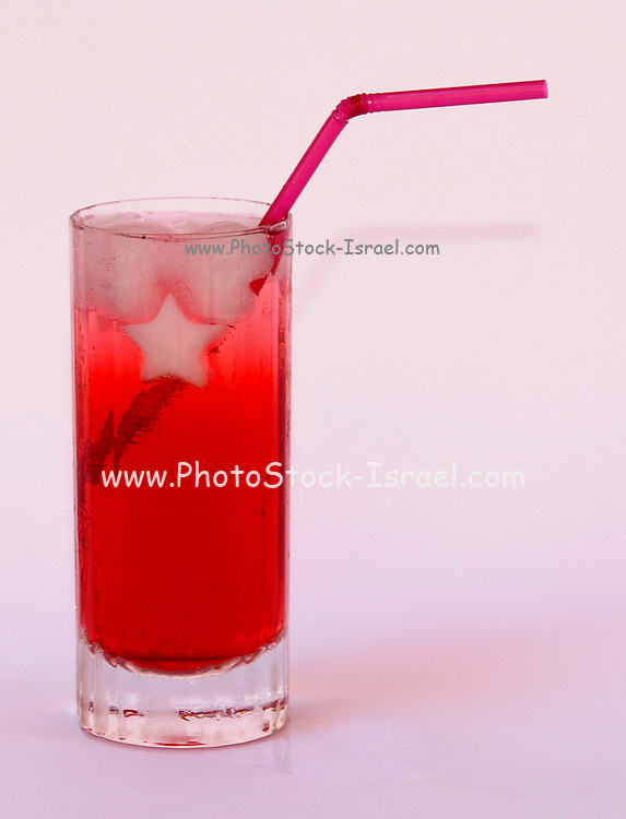A glass of ice cold pomegranate juice on white background