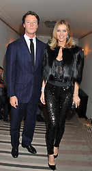 EVA HERZIGOVA and GREGORIO MARSIAJ at the Harper's Bazaar Women of the Year Awards 2011 held at Claridge's, Brook Street, London on 7th November 2011.