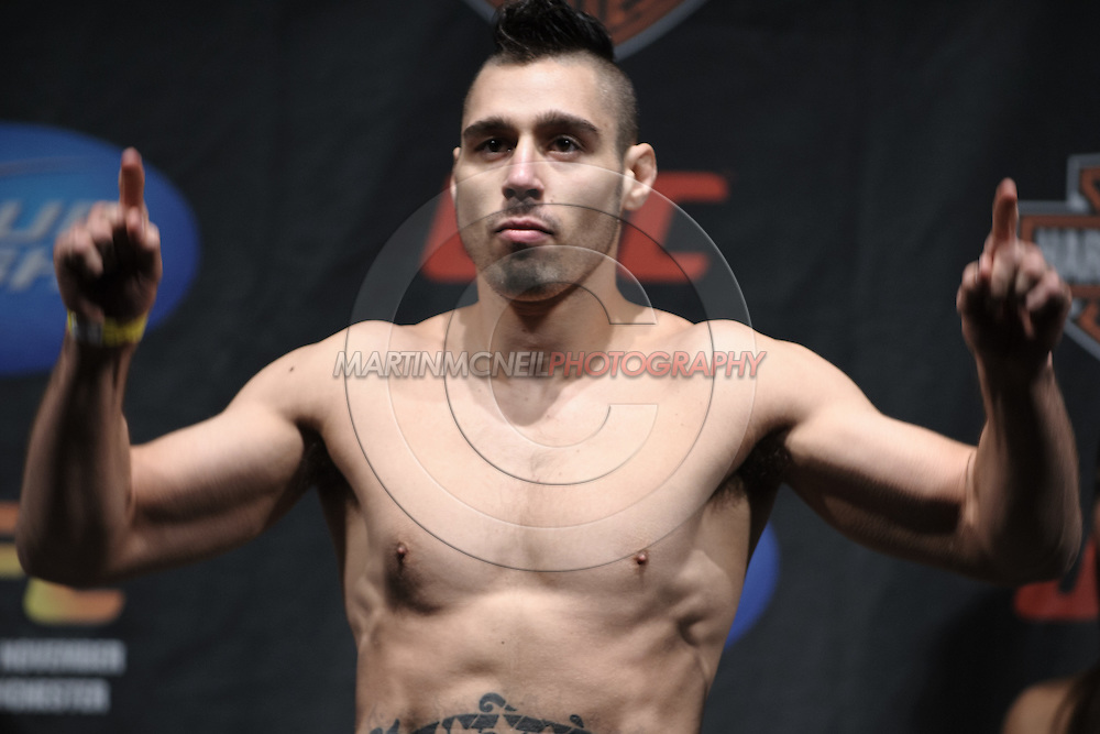 MANCHESTER, ENGLAND, NOVEMBER 13, 2009: Dan Hardy poses on the scales during the weigh-ins for UFC 105 at the MEN Arena in Manchester, England on November 13, 2009.