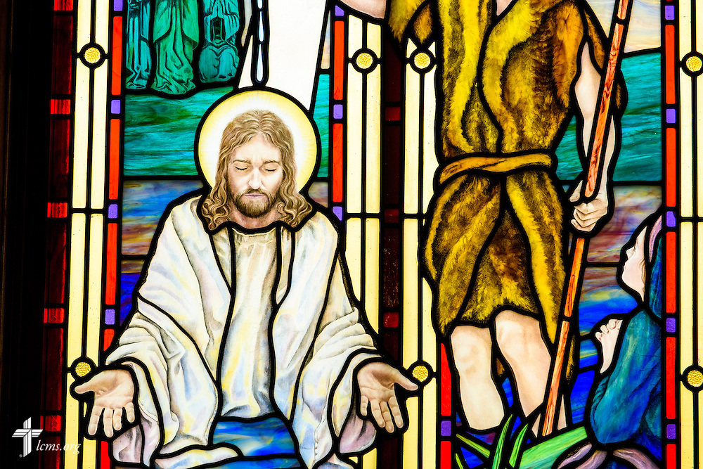 Stained glass at St. Paul Evangelical Lutheran Church in Columbus, Ind., depicts the baptism of Jesus Christ, photographed Sunday, April 10, 2016. LCMS Communications/Erik M. Lunsford