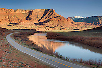 Utah State Highway 128 winding along the Colorado River, in the distance are the La Sal Mountains