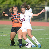 Pennsbury's Rosie Bostian (35) and Abington's Arianna Mancini (23) collide as they chase a loose ball in the first half Wednesday, October 04, 2017 at Abington High School in Abington, Pennsylvania. (Photo by William Thomas Cain)