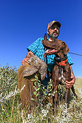John Zeman with GSP Louie and a Hungarian partridge in Montana.