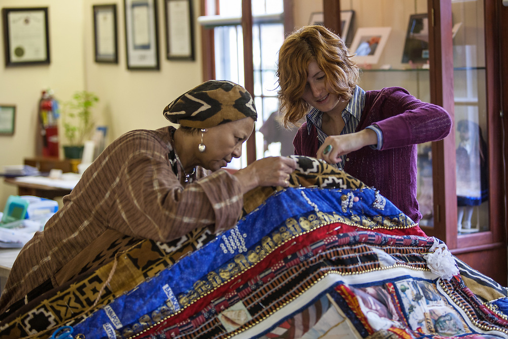 Shady Side, Maryland, US - 21 September 2009. Joan Gaither, left, helps a volunteer assemble a quilt pieced from memorabilia of black watermen at the Salem Avery Museum in Shady Sie, Maryland.