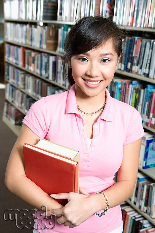 Female University student in library, portrait