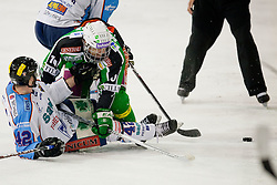 Brock McBride (HDD Tilia Olimpija, #10) and Marton Vas (SAPA Fehervar AV19, #42) during ice-hockey match between HDD Tilia Olimpija and SAPA Fehervar AV19 at fourth match in Quarterfinal  of EBEL league, on Februar 26, 2012 at Hala Tivoli, Ljubljana, Slovenia. HDD Tilia Olimpija won 6:4. (Photo By Matic Klansek Velej / Sportida)
