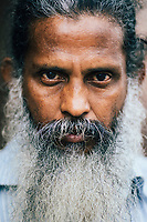 Kandy, Sri Lanka -- January 31, 2018: A portrait of a Sri Lankan man with a beard.