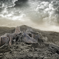 Ruins of Rocca Calascio, a mountaintop fortress or rocca in the Province of L'Aquila in Abruzzo, Italy. At an elevation of 1460 metres, the Rocca of Calascio is the highest fortress in the Apennines. Built of stone and masonry exclusively for military purposes and intended only to accommodate troops and never as residence for nobles, the fortress overlooks the Plain of Navelli at one of the highest points in the ancient Barony of Carapelle, Abruzzo, Italy