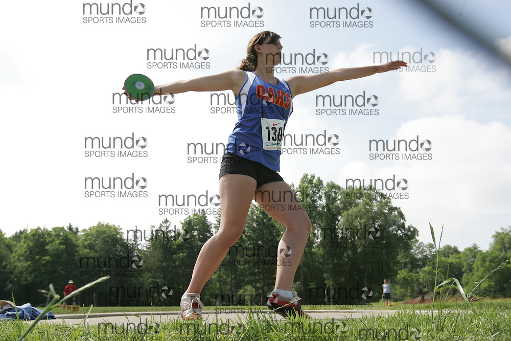 (London, Ontario}---04 June 2010) Katie Costello of Oakridge - London competing in the Discus at the 2010 OFSAA Ontario High School Track and Field Championships. Photograph copyright Sean Burges / Mundo Sport Images, 2010.