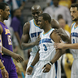 April 24, 2011; New Orleans, LA, USA; New Orleans Hornets point guard Chris Paul (3) reacts with teammates center Emeka Okafor (50) and shooting guard Marco Belinelli (8) after drawing a foul from the Los Angeles Lakers during the second quarter in game four of the first round of the 2011 NBA playoffs at the New Orleans Arena.    Mandatory Credit: Derick E. Hingle