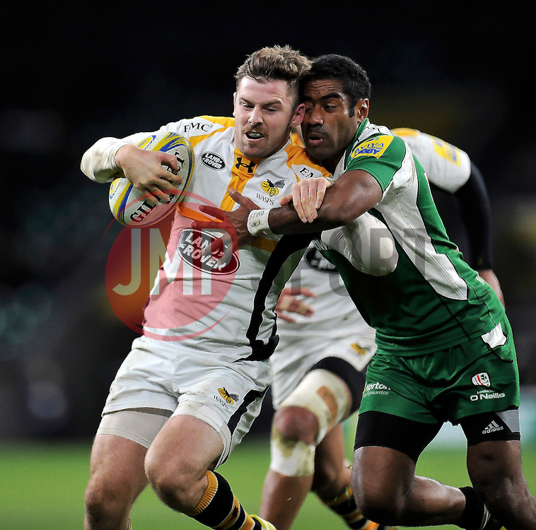 Elliot Daly of Wasps is tackled by Aseli Tikoirotuma of London Irish - Mandatory byline: Patrick Khachfe/JMP - 07966 386802 - 28/11/2015 - RUGBY UNION - Twickenham Stadium - London, England - London Irish v Wasps - Aviva Premiership.