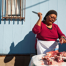 101813       Brian Leddy<br /> Majel Brown uses a knife to crack bones for soup during a celebration at Navajo Technical University in Chinle. the school butchered several sheep in honor of being designated as university status.