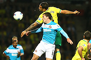 Picture by Paul Chesterton/Focus Images Ltd.  07904 640267.26/9/11.Bradley Johnson of Norwich and Craig Gardner of Sunderland in action during the Barclays Premier League match at Carrow Road stadium, Norwich.