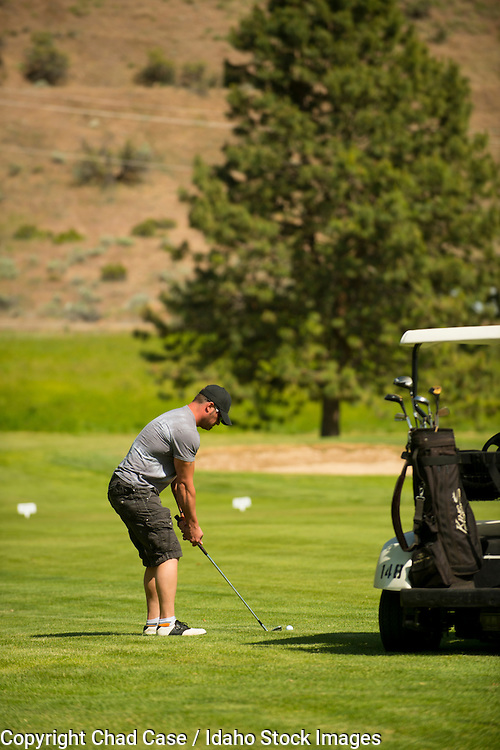 Golfers at Boise's Warm Springs Golf Course. Model release.