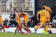 Grimsby Town defender Ben Davies (2) shoots at goal and Port Vale defender Joe Davis (5) blocks the shot during the EFL Sky Bet League 2 match between Grimsby Town FC and Port Vale at Blundell Park, Grimsby, United Kingdom on 10 March 2018. Picture by Mick Atkins.