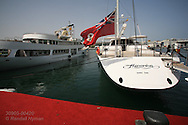 Luxury yachts sit tied up at superyacht marina in Port America's Cup; Valencia, Spain.