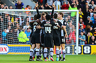 Daniel Tozser of Watford (arms aloft) celebrates scoring his team's second goal against Millwall to make it 2-1 with team mates during the Sky Bet Championship match at Vicarage Road, Watford<br /> Picture by David Horn/Focus Images Ltd +44 7545 970036<br /> 01/11/2014