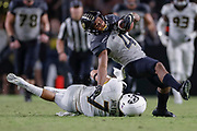 WEST LAFAYETTE, IN - SEPTEMBER 15: Rondale Moore #4 of the Purdue Boilermakers is tripped up after the catch by Cam Hilton #7 of the Missouri Tigers in the fourth quarter at Ross-Ade Stadium on September 15, 2018 in West Lafayette, Indiana. (Photo by Michael Hickey/Getty Images) *** Local Caption *** Rondale Moore; Cam Hilton NCAA Football - Purdue Boilermakers vs Missouri Tigers at Ross-Ade Stadium in West Lafayette, Indiana. Sports photographer by Michael Hickey