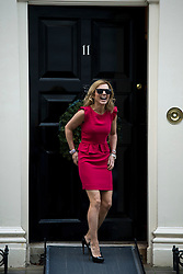 © London News Pictures. 11/12/2012. London, UK . Spice Girl Geri Halliwell posing for a photo as she arrives at number 11 Downing Street for the 11 Downing Street Christmas party hosted by Chancellor of the Exchequer George Osbourne on December 11, 2012. The annual party is held in conjunction with children's charity Starlight. Photo credit: Ben Cawthra/LNP