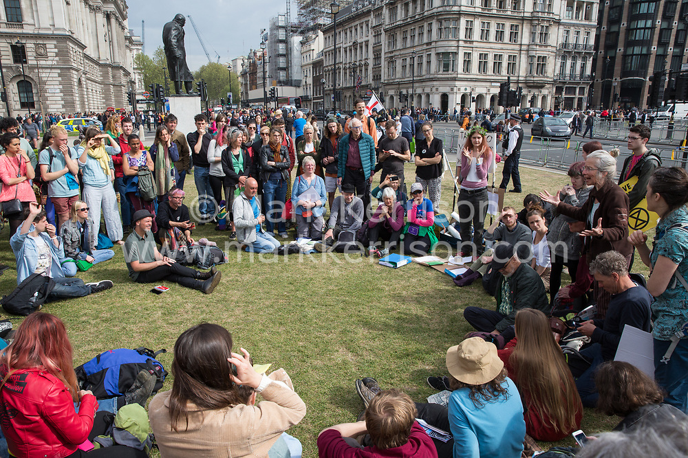London, UK. 24th April 2019. Climate change activists from Extinction Rebellion gather in Parliament Square on the tenth day of the International Rebellion to call on the British government to take urgent action to counter climate change.