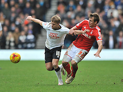 Nottingham Forest's Robert Tesche challenges Derby County's Jamie Ward - Photo mandatory by-line: Dougie Allward/JMP - Mobile: 07966 386802 - 17/01/2015 - SPORT - Football - Derby - iPro Stadium - Derby County v Nottingham Forest - Sky Bet Championship