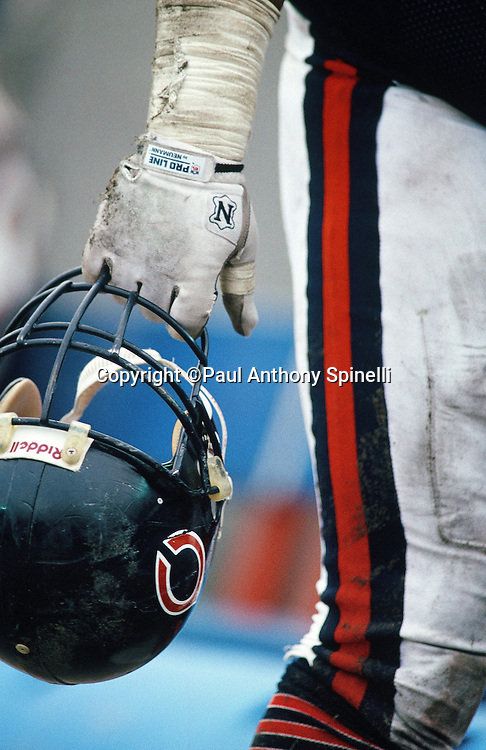 A Chicago Bears player holds his helmet by the face mask at his side during the NFL NFC Wild Card playoff football game against the Dallas Cowboys on Dec. 29, 1991 in Chicago. The Cowboys won the game 17-13. (©Paul Anthony Spinelli)