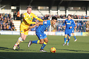 AFC Wimbledon striker Lyle Taylor (33) shields the ball during the EFL Sky Bet League 1 match between AFC Wimbledon and Millwall at the Cherry Red Records Stadium, Kingston, England on 2 January 2017. Photo by Stuart Butcher.