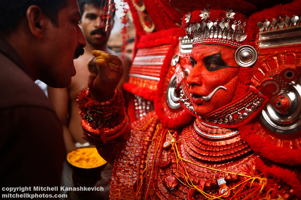 Theyyam Performance, Kannur District, Kerala India. .It is believed that while performing; the artist is possessed by a divine spirit and becomes a God - or Theyyam in the local language. In Hinduism there are literally millions of Gods; both good and evil and The four hundred existing variations of Theyyam performances are dedicated to just some of them.