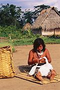 Yaminahua Indian working with home grown Cotton<br />