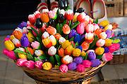 Wooden painted tulips in wicker basket, Delft, Netherlands