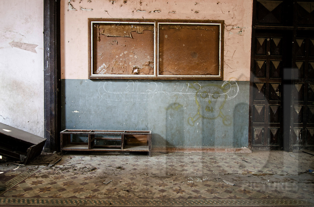 Abandoned Sengchaleun cinema, Savannakhet, Laos, Asia. Interiors are in complete decay and very messy. skull and crossbones graff is painted on the wall