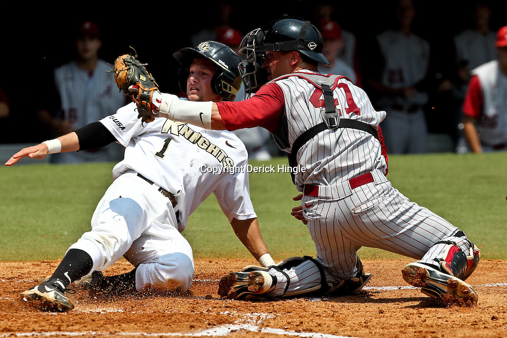 June 03, 2011; Tallahassee, FL, USA;  UCF Knights second baseman Travis Shreve is tagged out by Alabama Crimson Tide catcher Brock Bennett (41) at home plate during the 2011 Tallahassee Regional at Dick Howser Stadium. Alabama defeated UCF 5-3. Mandatory Credit: Derick E. Hingle