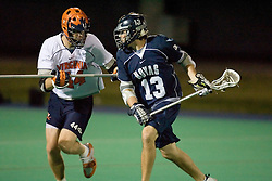 Georgetown Hoyas M Dan D'Agnes (13) and Virginia Cavaliers LSM Mike Timms (44)...The Virginia Cavaliers men's lacrosse team faced the Georgetown Hoyas in a Fall Ball Scrimmage held at the University Hall Turf Field in Charlottesville, VA on October 12, 2007.