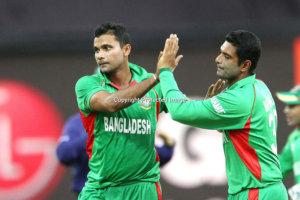 Mashrafe Mortaza celebrates the wicket of James Franklin during the ICC World Twenty20 Pool match between New Zealand and Bangladesh held at the  Pallekele Stadium in Kandy, Sri Lanka on the 21st September 2012<br /> <br /> Photo byRon Gaunt/SPORTZPICS/PHOTOSPORT