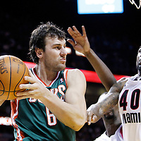 22 January 2012: Milwaukee Bucks center Andrew Bogut (6) looks to pass past Miami Heat power forward Udonis Haslem (40) during the Milwaukee Bucks 91-82 victory over the Miami Heat at the AmericanAirlines Arena, Miami, Florida, USA.