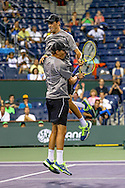 Indian Wells, CA - Bob and Mike Bryan of USA celebrate the championship title at the BNP Paribas Open in Indian Wells, California against Alexander Peya of Austria and Bruno Soares of Brazil.