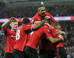 Cardiff City's Steven Caulker is mobbed by team mates after scoring - Photo mandatory by-line: Joe Meredith/JMP - Tel: Mobile: 07966 386802 03/11/2013 - SPORT - FOOTBALL - The Cardiff City Stadium - Cardiff - Cardiff City v Swansea City - Barclays Premier League