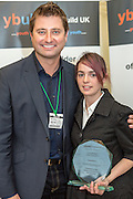 George Clarke with the over all winner Kimberly Beagan. <br /> Young Builder of the Year Awards 2013, House of Commons, Westminster, London.