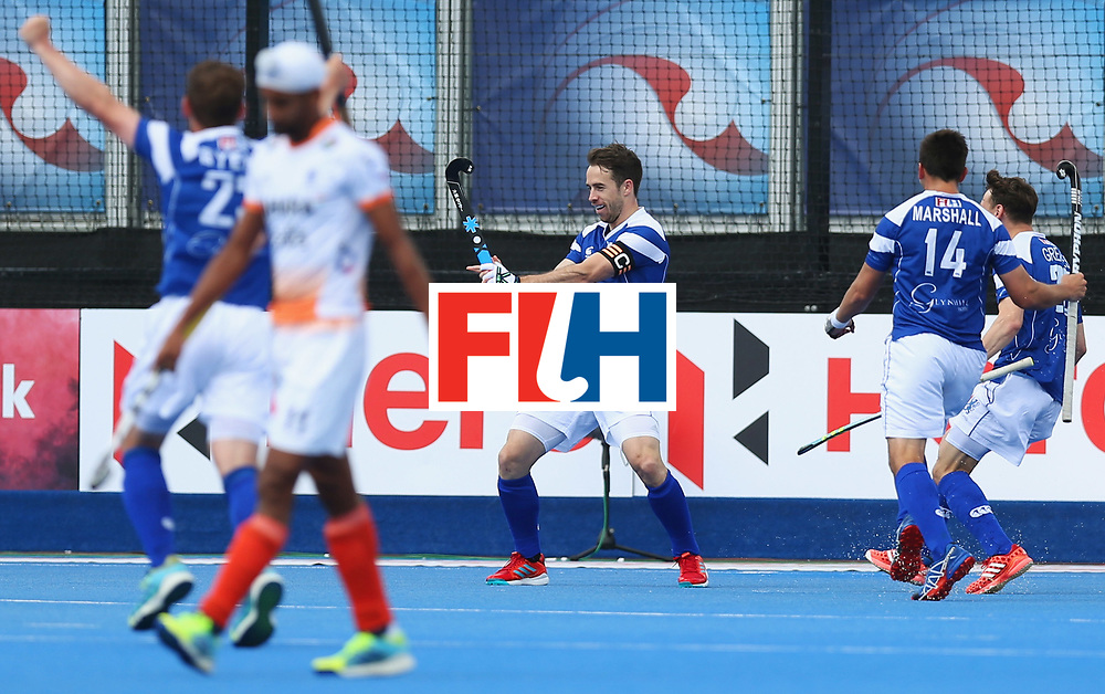 LONDON, ENGLAND - JUNE 15:  Chris Grassick of Scotland (C) celebrates as he scores their first goal with team mates during the Pool B match between India and Scotland on day one of Hero Hockey World League Semi-Final at Lee Valley Hockey and Tennis Centreo n June 15, 2017 in London, England.  (Photo by Alex Morton/Getty Images)