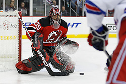 Feb 9, 2009; Newark, NJ, USA; New Jersey Devils goalie Scott Clemmensen (35) makes a save during the third period at the Prudential Center. The Devils defeated the Rangers 3-0.  Clemmenson recorded the shutout win.