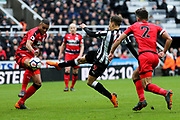 Dwight Gayle (#9) of Newcastle United fires a shot towards goal during the Premier League match between Newcastle United and Huddersfield Town at St. James's Park, Newcastle, England on 31 March 2018. Picture by Craig Doyle.