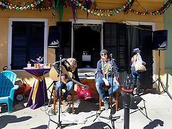 09 February 2016. New Orleans, Louisiana.<br /> Mardi Gras Day. Adrian Simpson hosts yet another fabulous party in the French Quarter. Terry McDermott sets up to sing.<br /> Photo©; Charlie Varley/varleypix.com