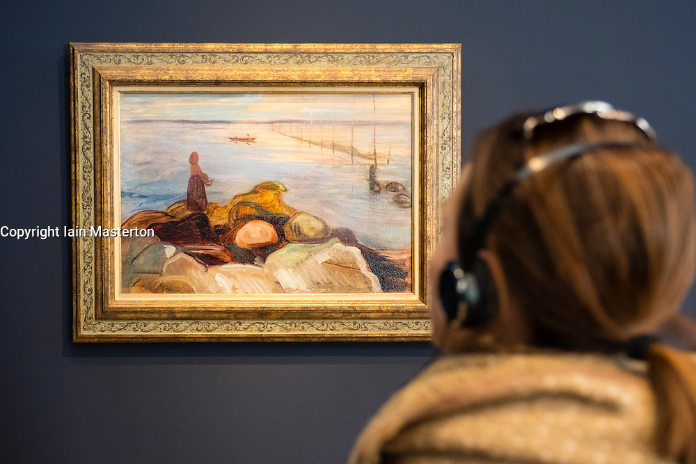 Visitor looking at painting, Woman by the Sea in Asgardstrand by Edvard Munch,  at new Museum Barberini in Potsdam Germany