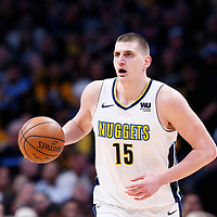 09 April 2018: Denver Nuggets center Nikola Jokic (15) brings the ball up court during the Denver Nuggets 88-82 victory over the Portland Trail Blazers, at the Pepsi Center, Denver, Colorado, USA.