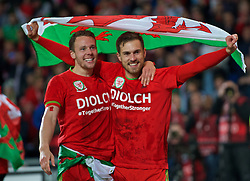 CARDIFF, WALES - Tuesday, October 13, 2015: Wales' Aaron Ramsey and Chris Gunter celebrate qualifying for the finals after a 2-0 victory over Andorra during the UEFA Euro 2016 qualifying Group B match at the Cardiff City Stadium. (Pic by Ian Cook/Propaganda)