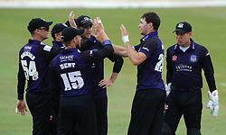 James Fuller of Gloucestershire celebrates with team mates - Photo mandatory by-line: Dougie Allward/JMP - Mobile: 07966 386802 - 12/07/2015 - SPORT - Cricket - Cheltenham - Cheltenham College - Natwest Blast T20