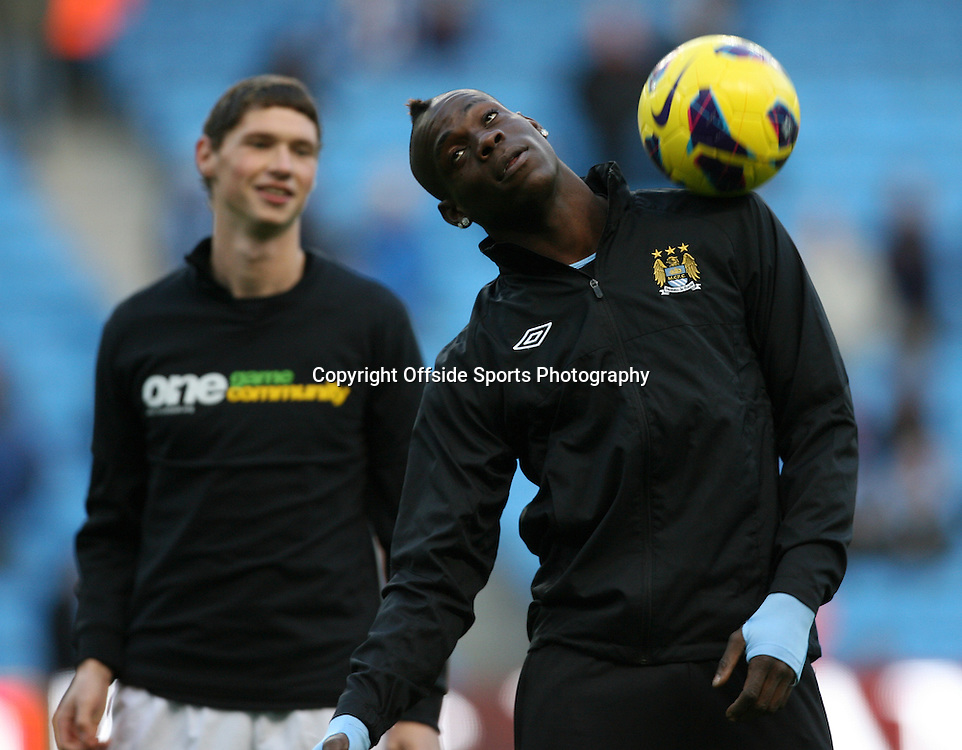 27th October 2012 - Barclays Premier League - Manchester City vs. Swansea City - Mario Balotelli of Man City fails to wear a 'Kick It Out' anti-racism t-shirt during the warm-up - Photo: Simon Stacpoole / Offside.