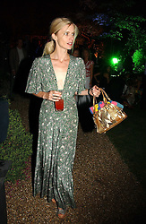 Model LAURA BAILEY at the Quintessentially Summer Party held at Debenham House, 8 Addison Road, London W14 on 15th June 2006.<br />